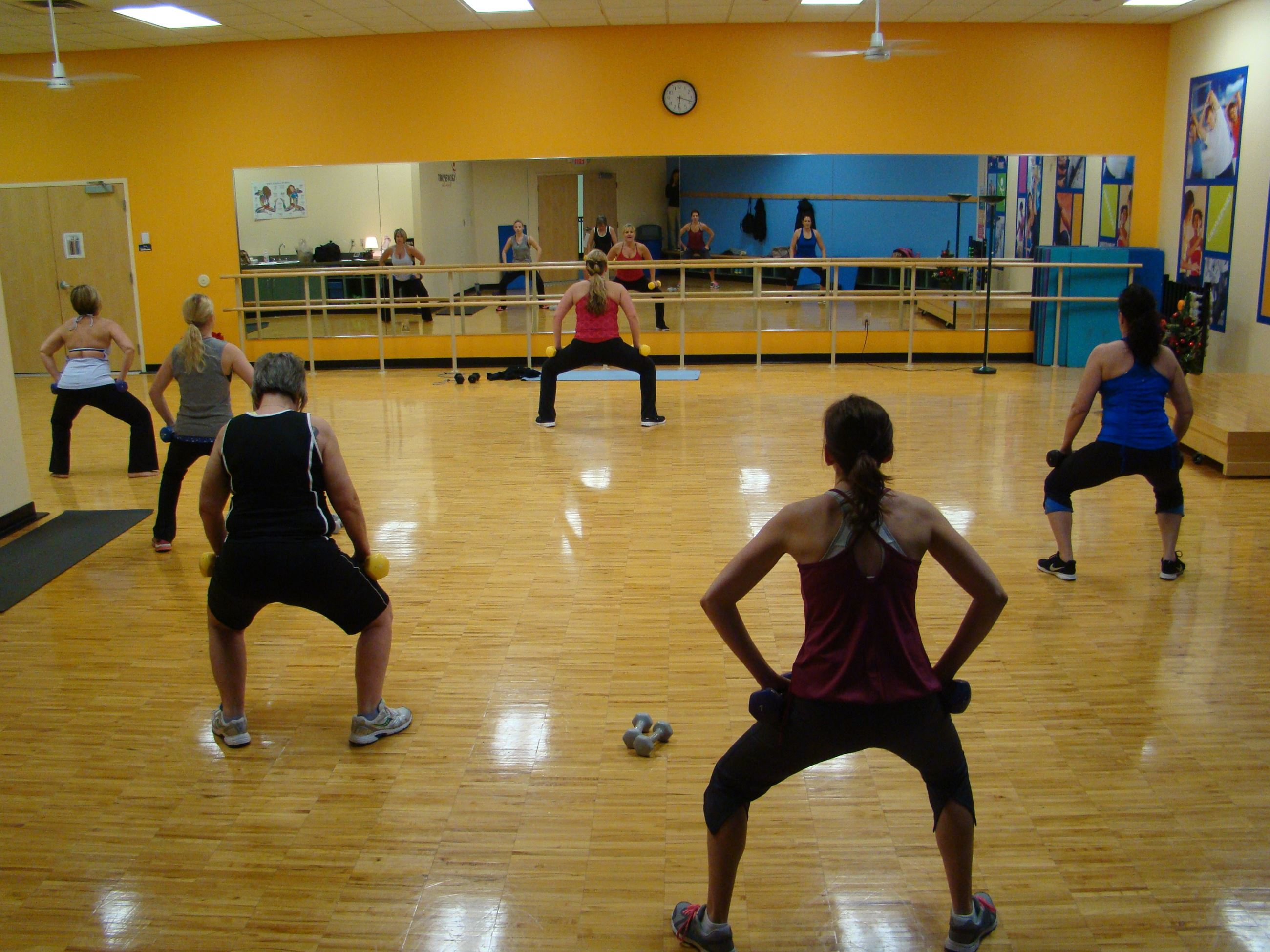 People exercising together in the Recreation Center's Group Fitness Studio.